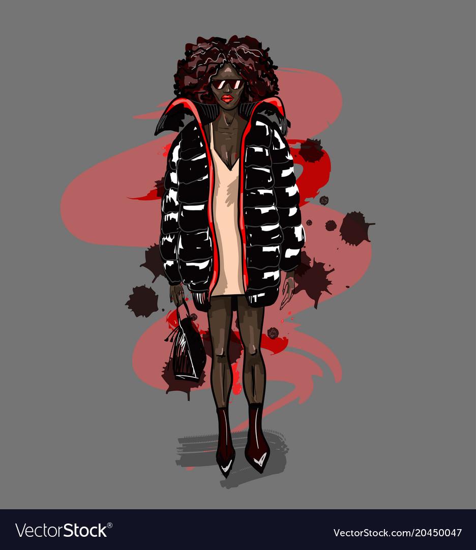 Black fashion girl in big coat with bag