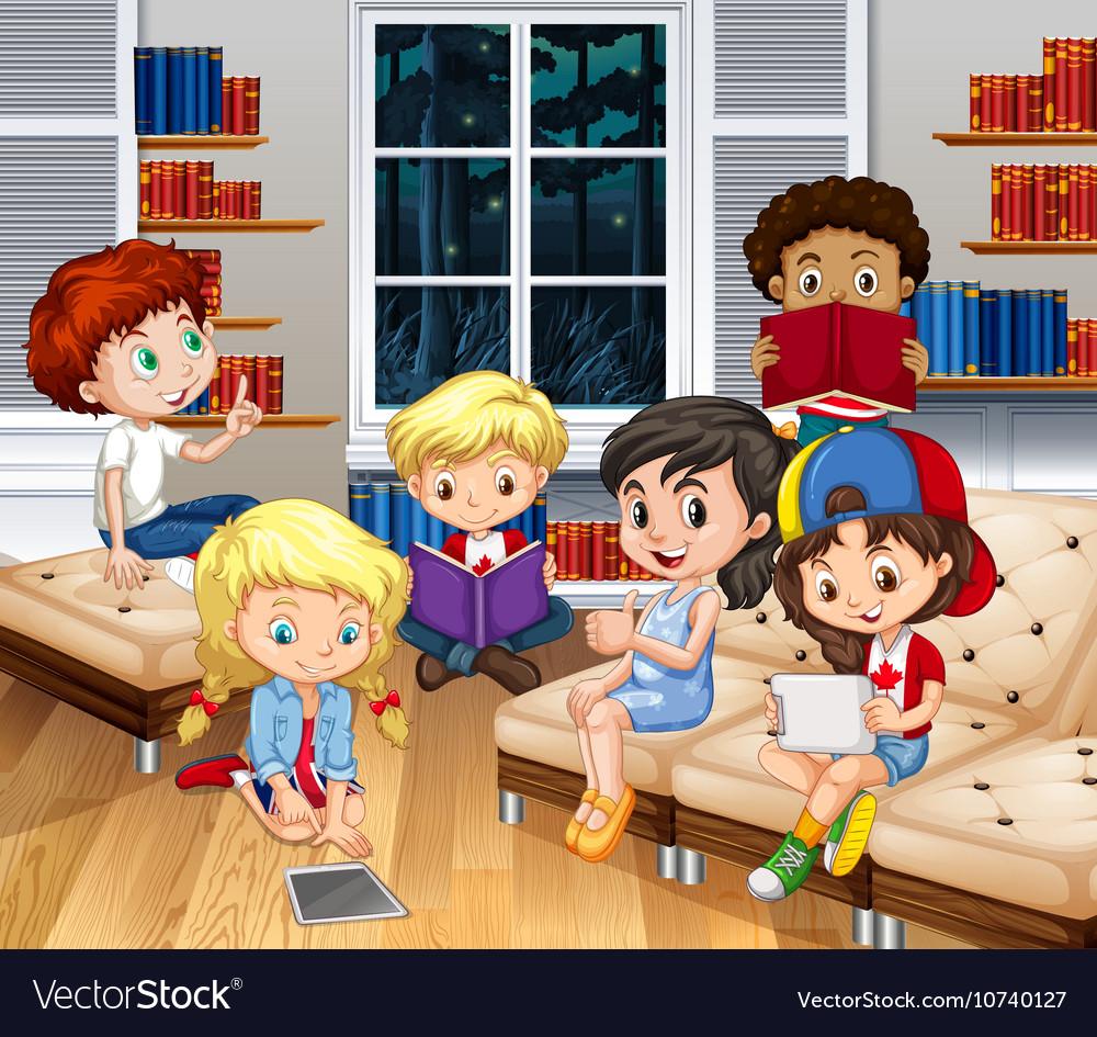 Children reading books in living room