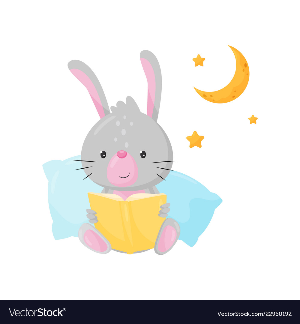 Cute little bunny reading a book at bedtime