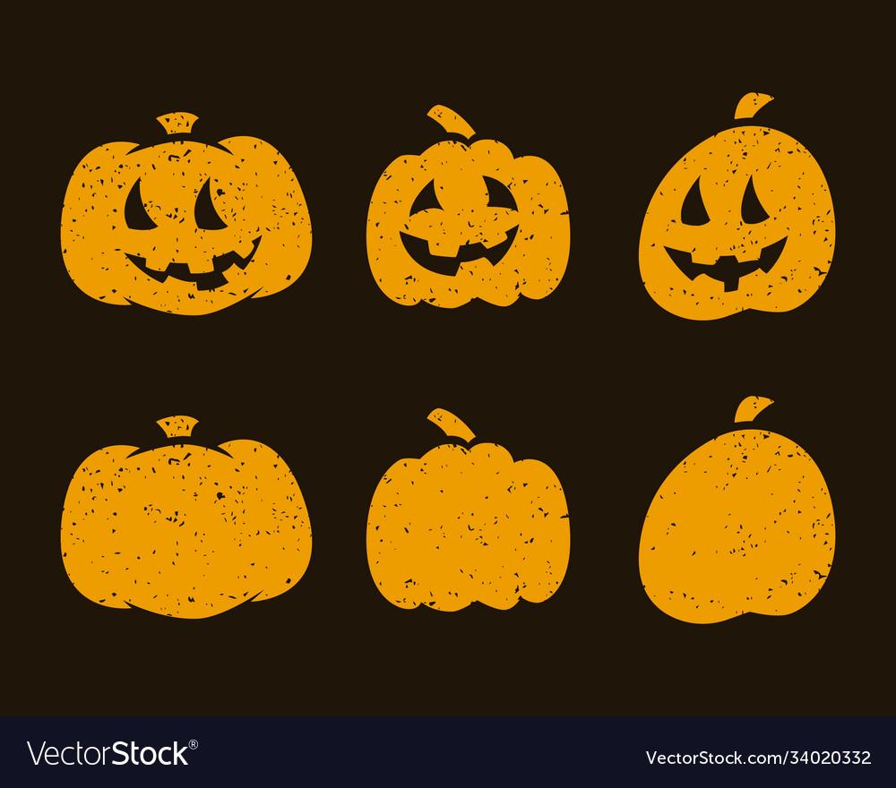 Halloween scary pumpkins on dark background