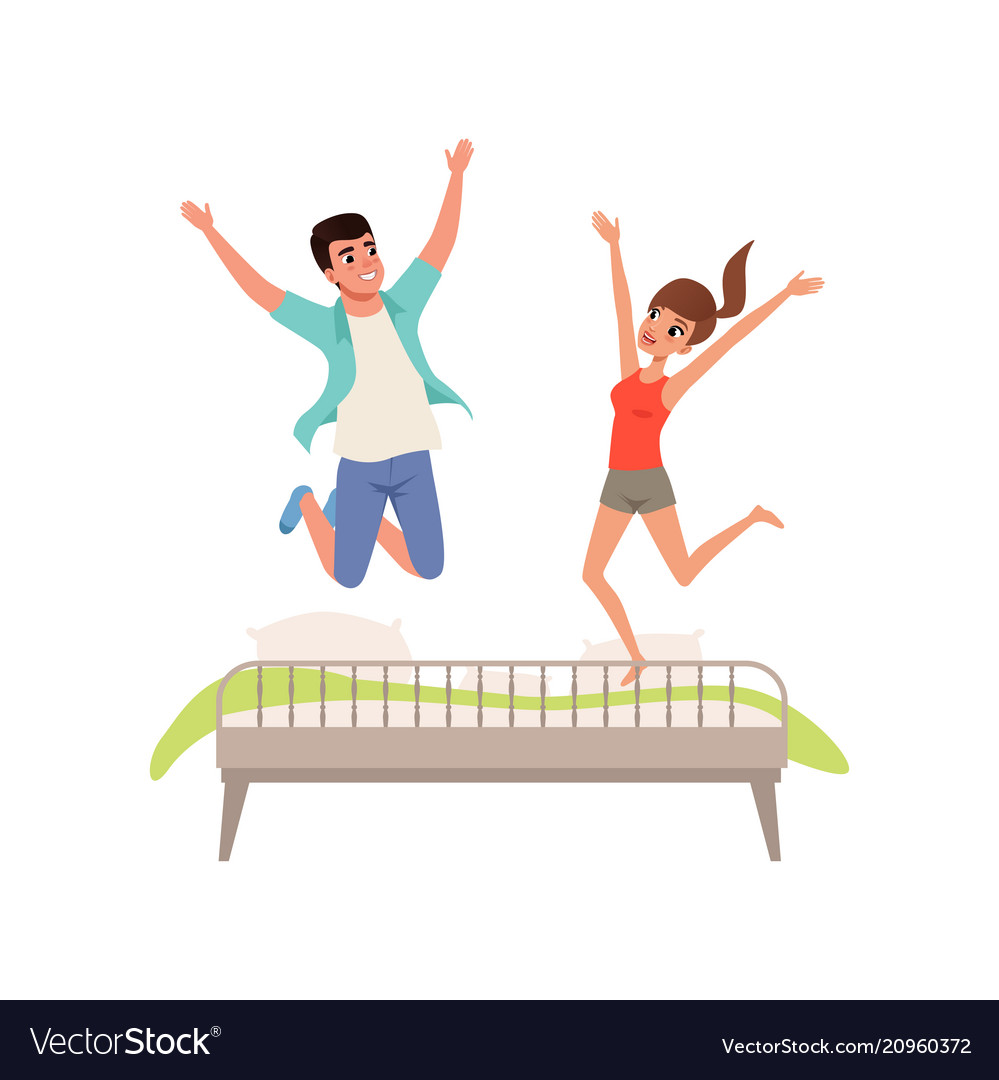 Happy romantic couple jumping on the bed