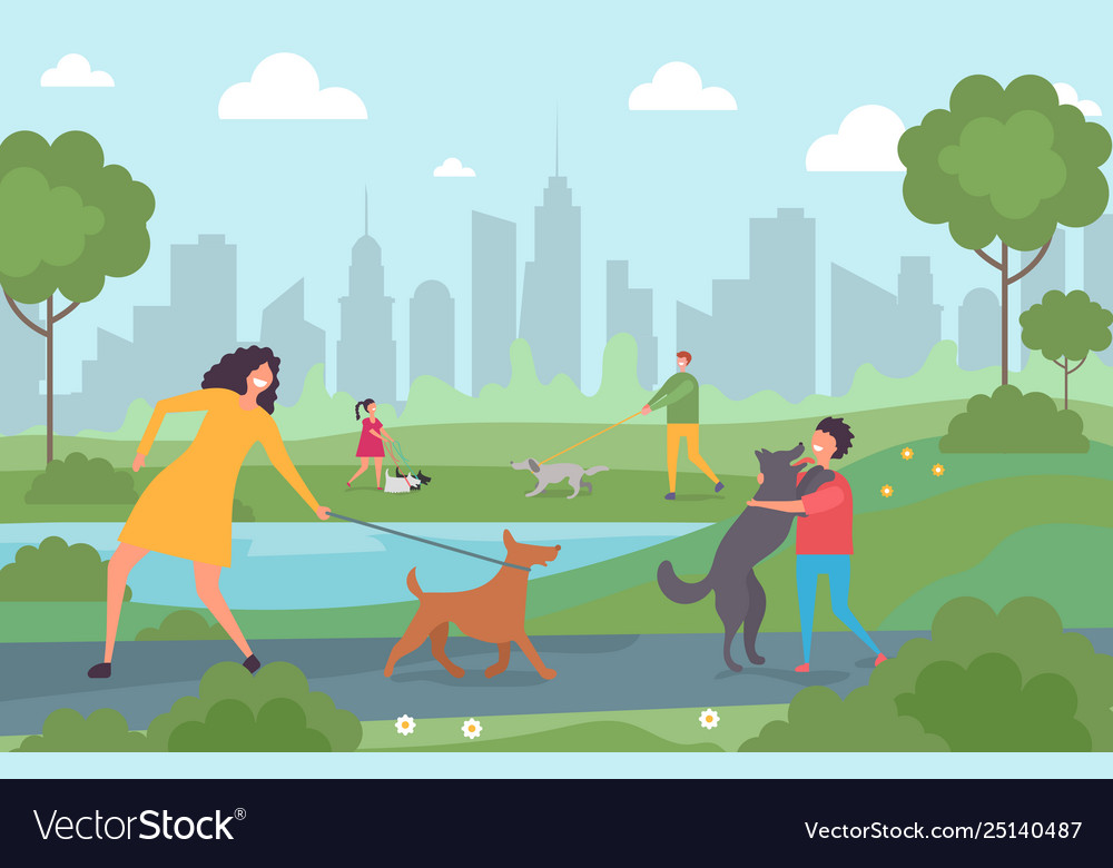 Happy people walking with dogs in city park