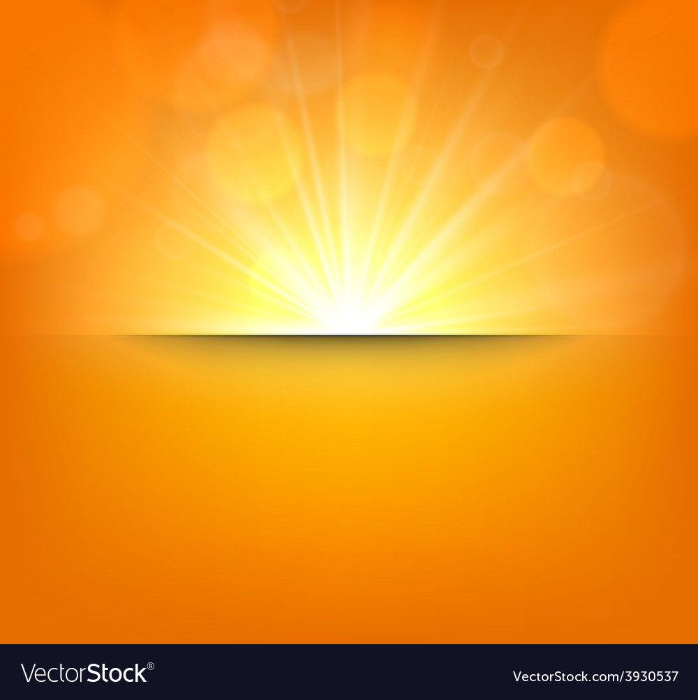 Blurry orange background with lens flare