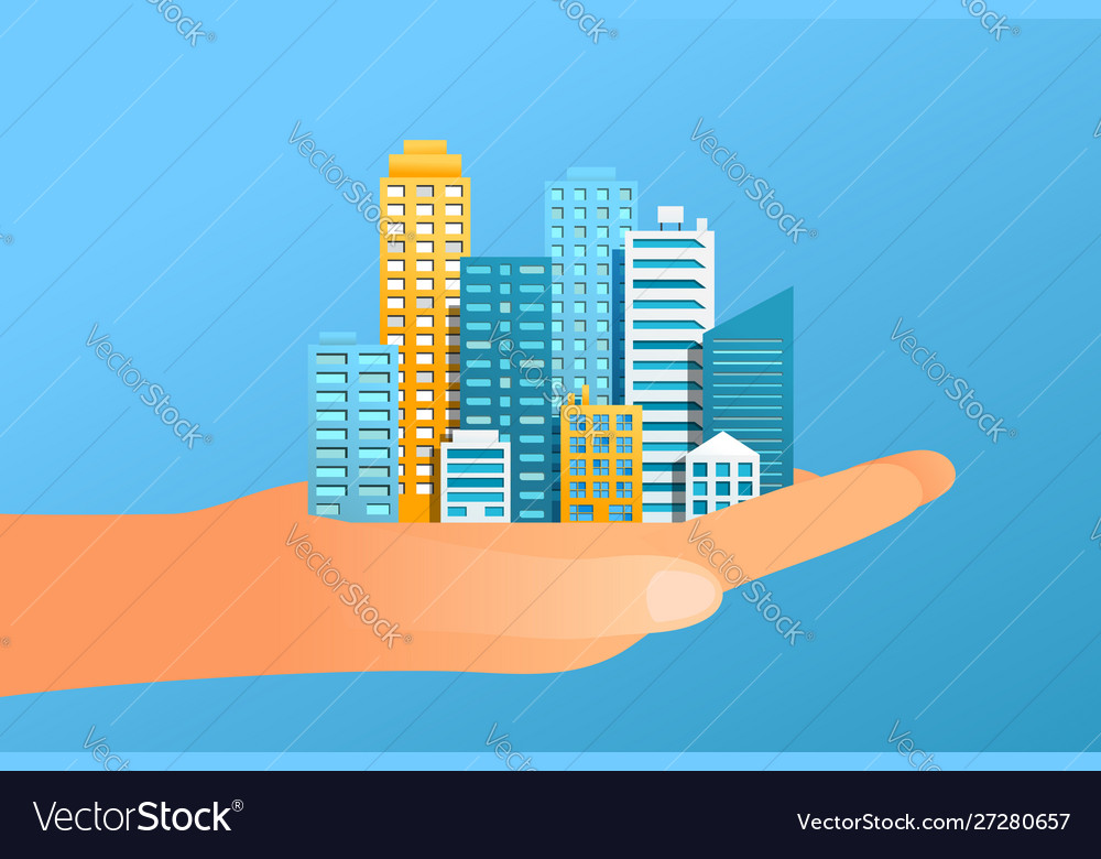 Human hand holding modern city