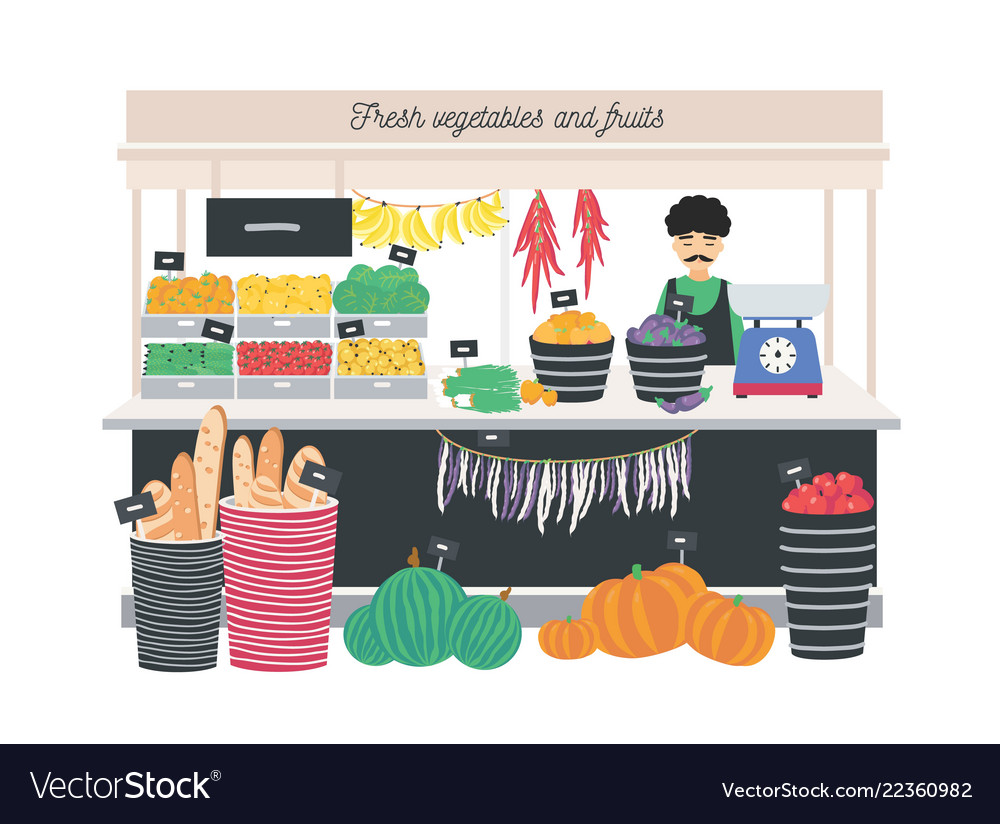 Greengrocer seller standing at counter stall or