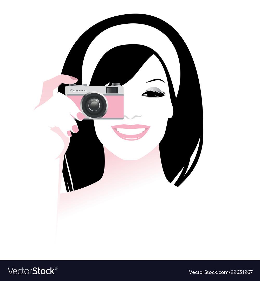 Beautiful smiling girl holding a retro photo