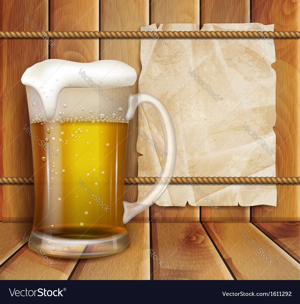 Glass of beer and a wooden background
