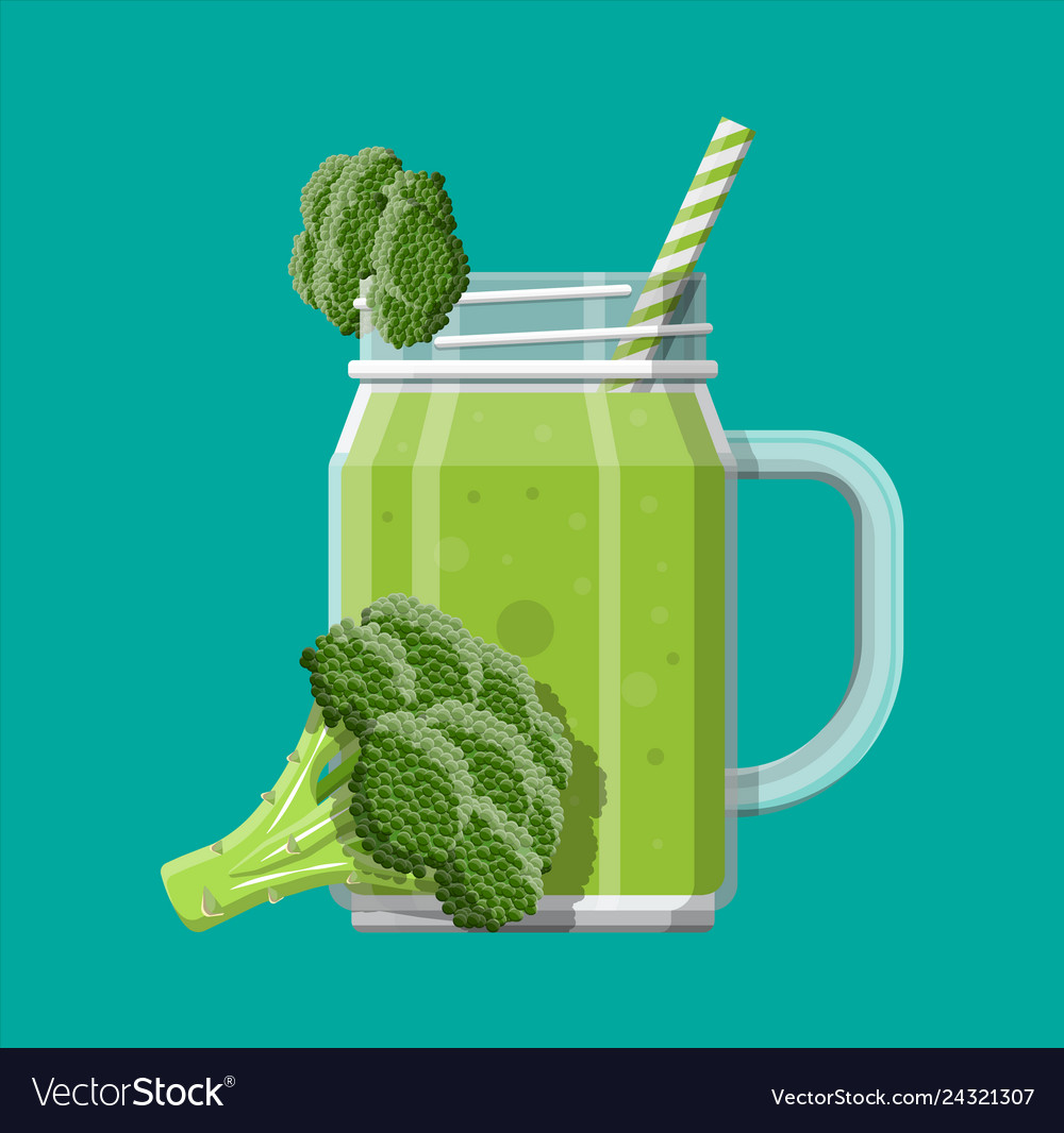 Jar with broccoli smoothie with striped straw