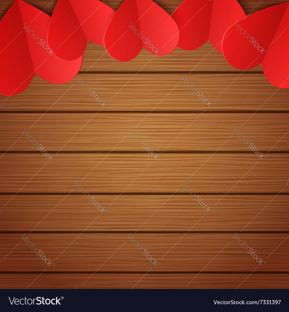 Wooden background with red paper hearts