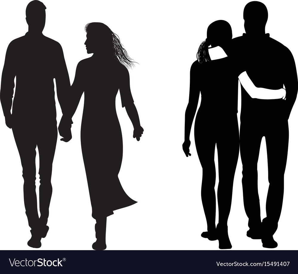 Silhouette of a couple walking next to each other