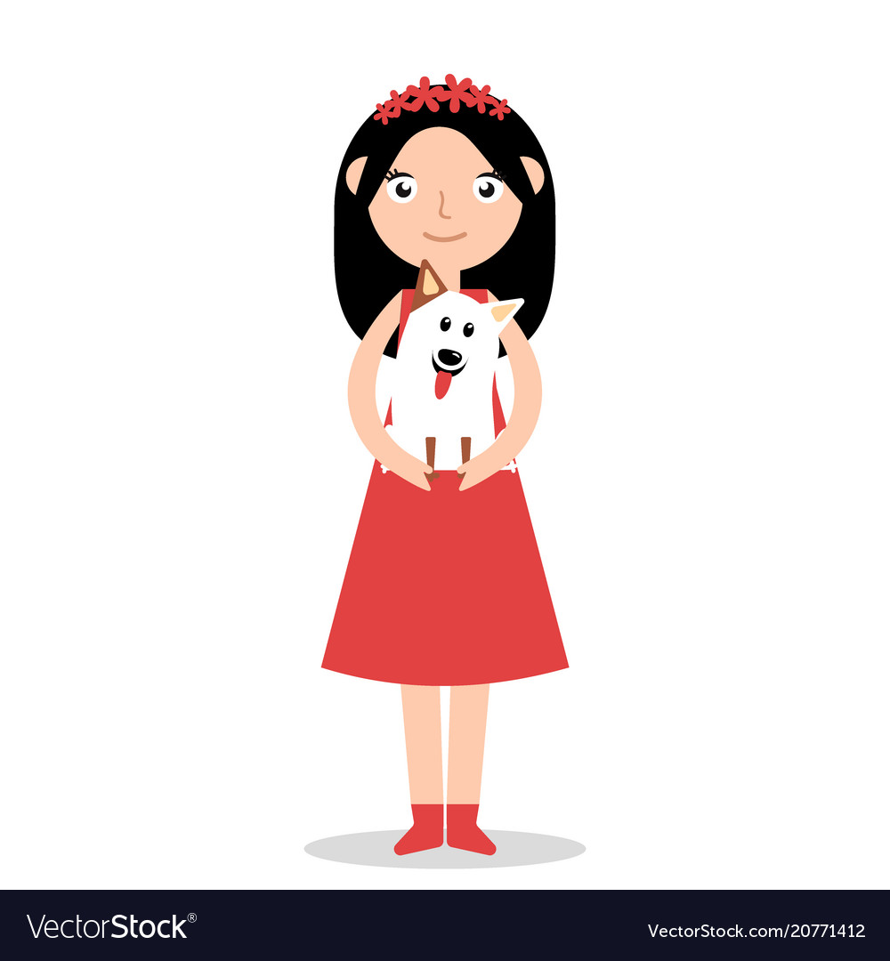 Happy girl holding a dog in her arms and smiling