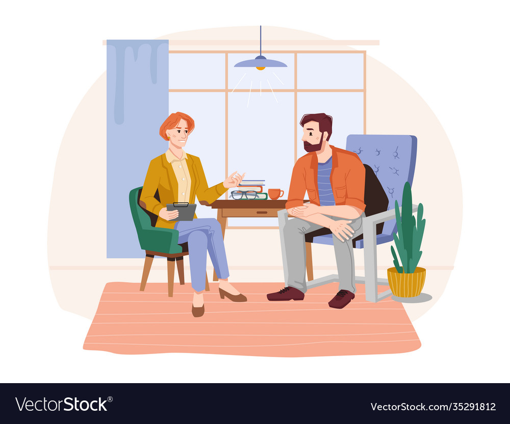 Female psychologist talking to patient in office