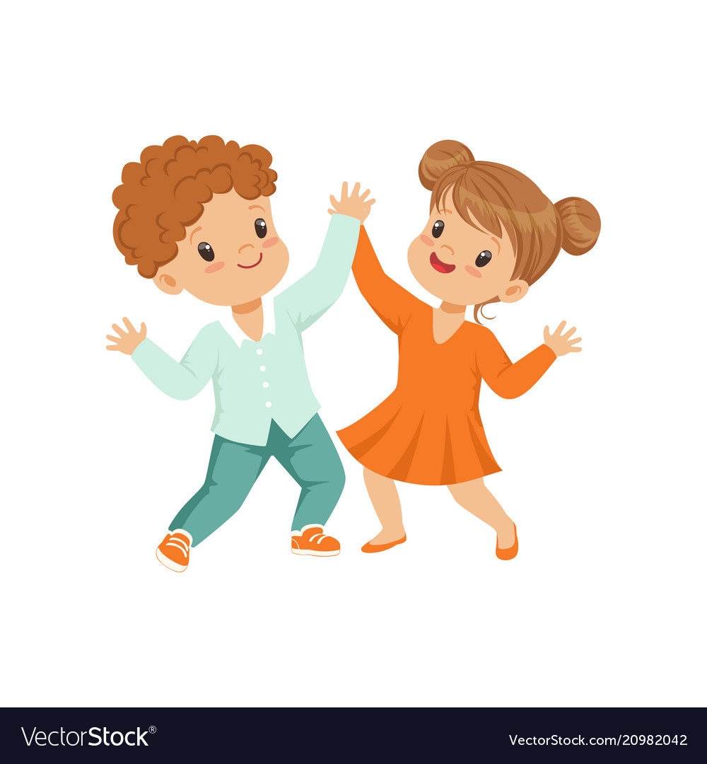 Cute little boy and girl dancing holding hands