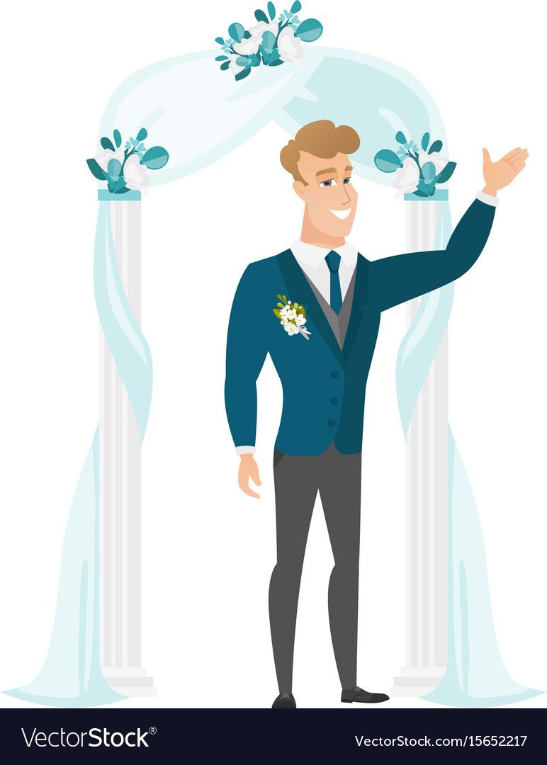 Happy groom standing under the wedding arch