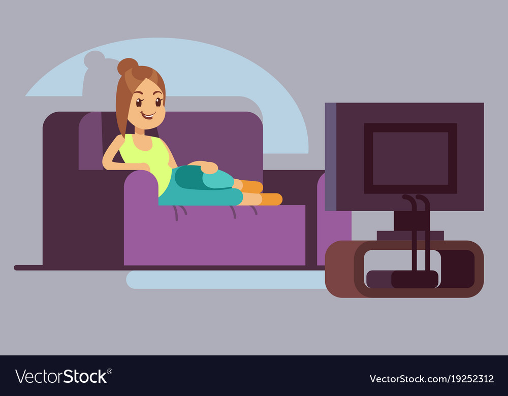 Happy young woman watching tv and lying on sofa