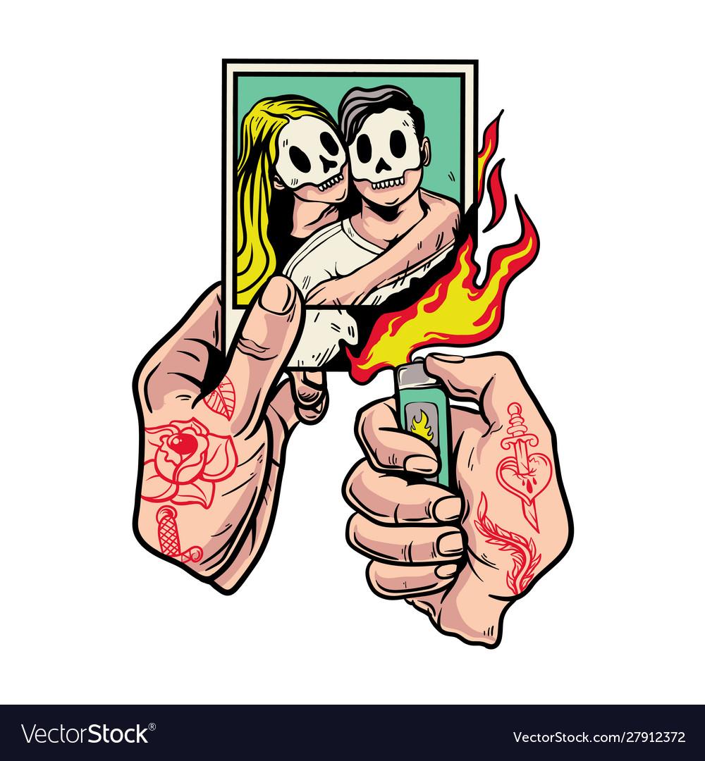 Hands with tattoo burning polaroid photos i