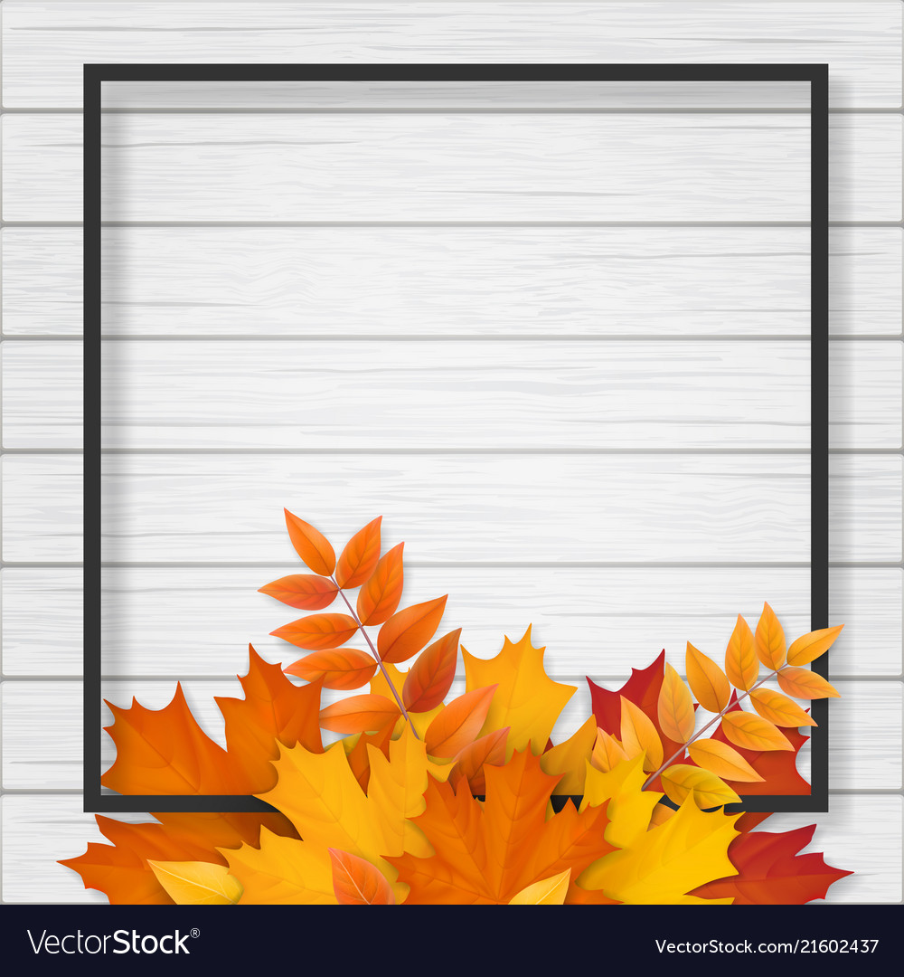 Frame with autumn leaves on wooden background