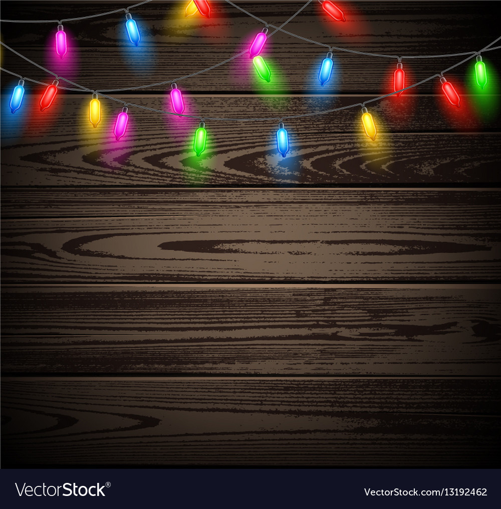 Free Christmas Lights.Wooden Background With Christmas Lights