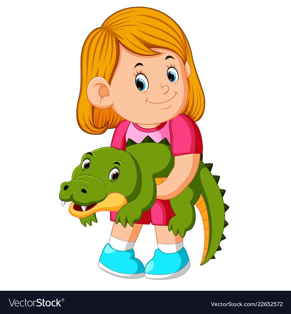 A little girl holding crocodille