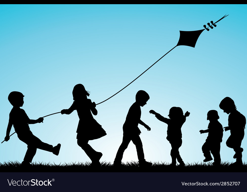 Group of children silhouettes with a kite outdoor