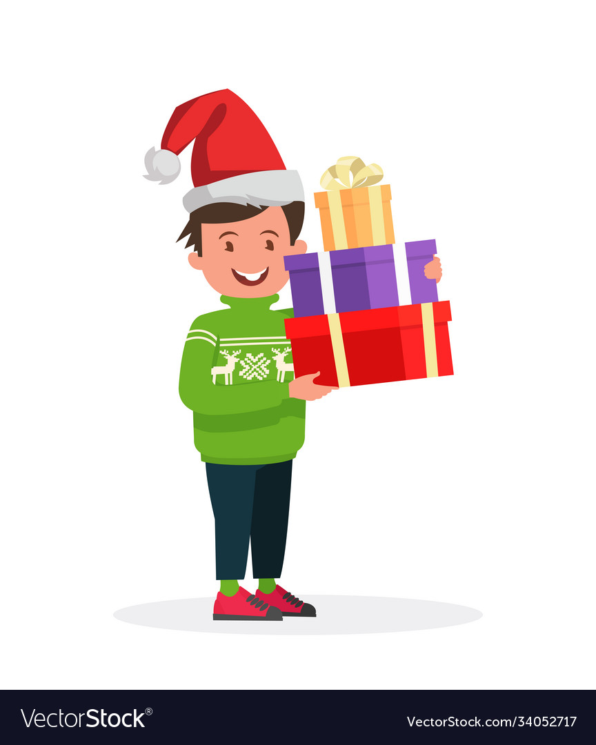 Happy boy in christmas hat with a gift for a