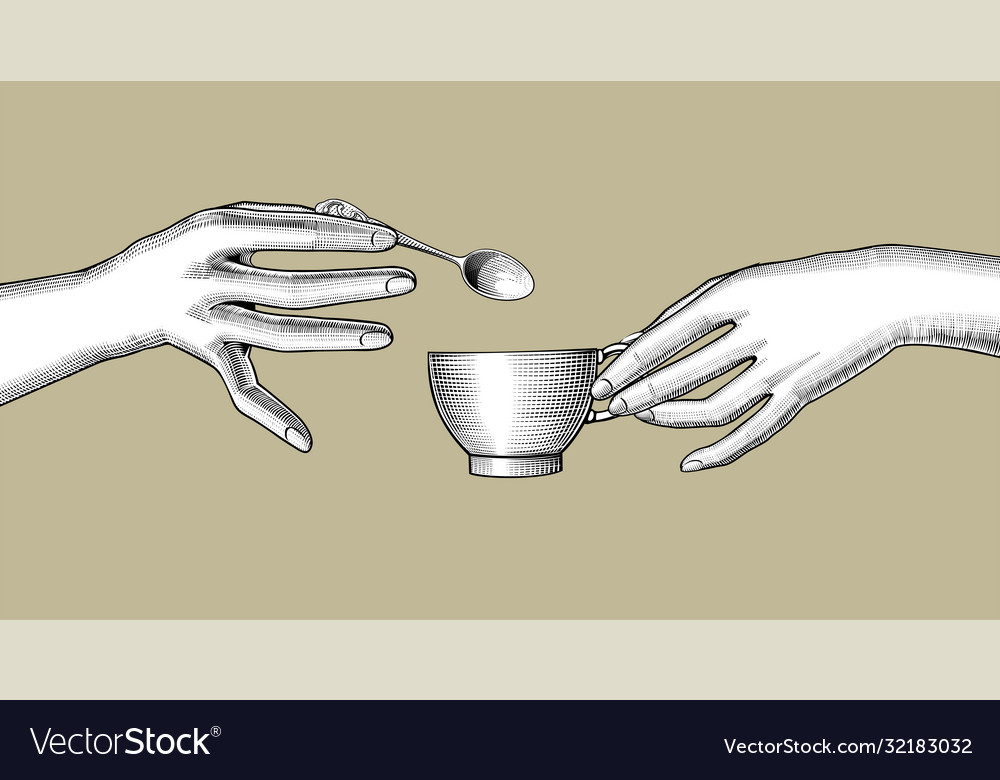 Female hands with a cup coffee and a small