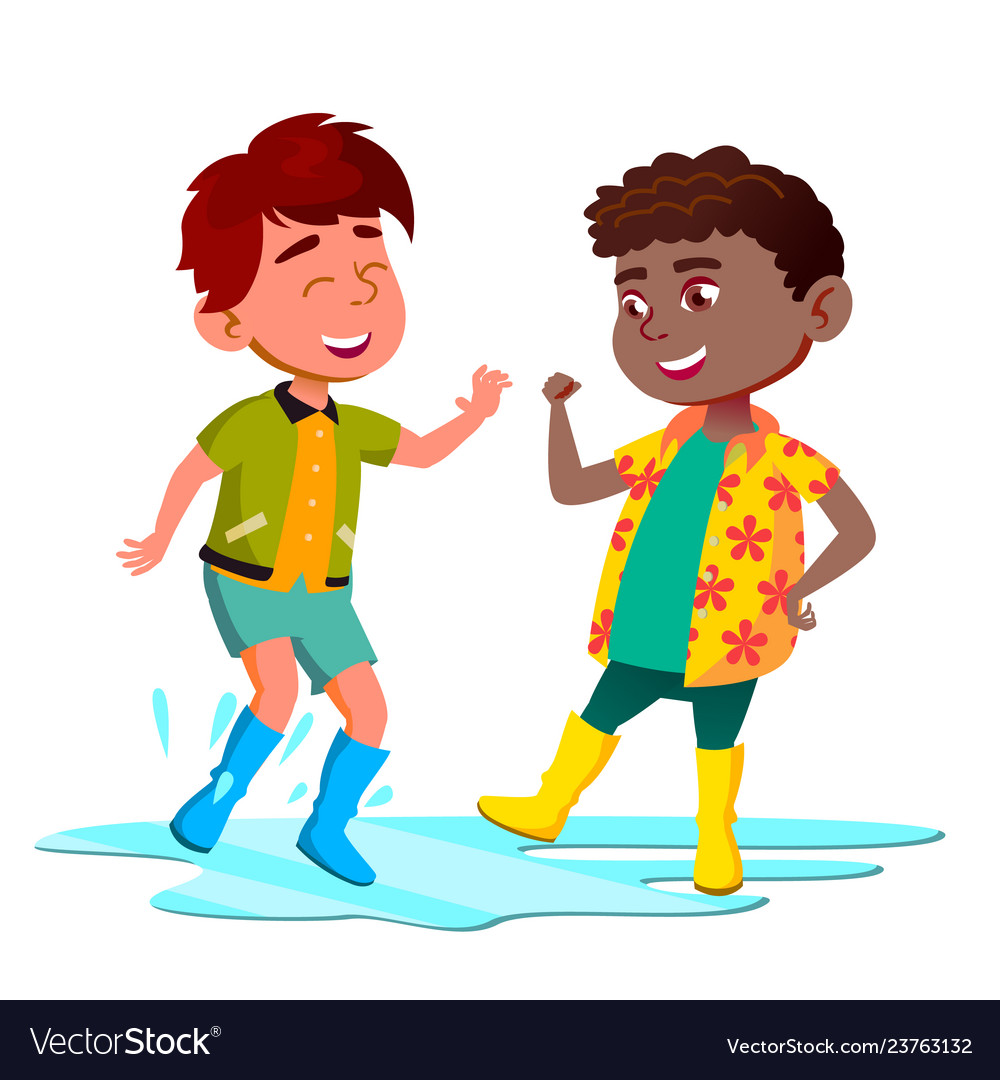 African and asian kids in boots jump in puddle