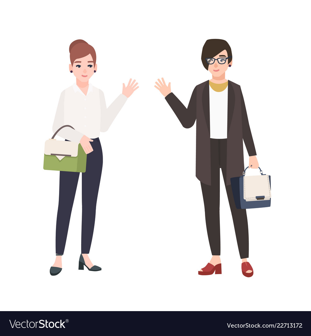 Pair smiling women dressed in business clothes