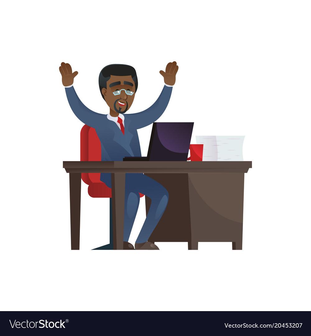Cheerful black businessman at laptop