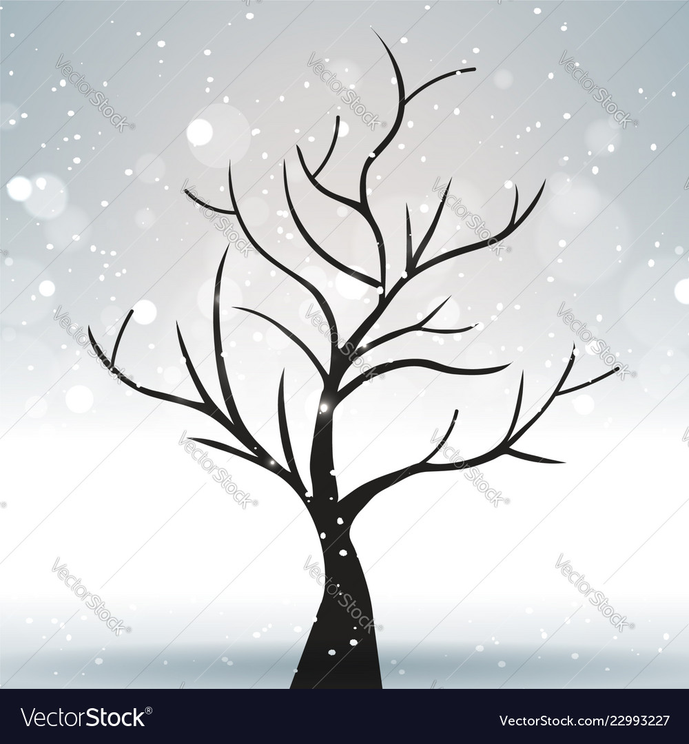A tree against a winter and gray landscape with