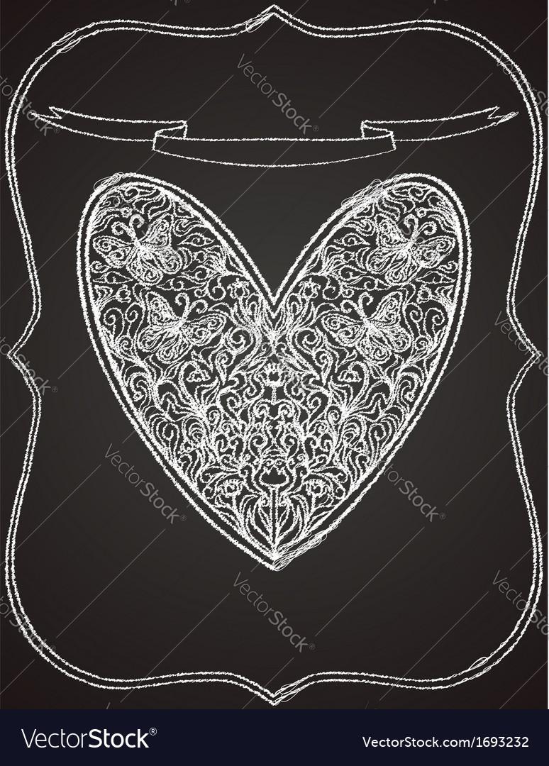 White heart shape on black chalk board