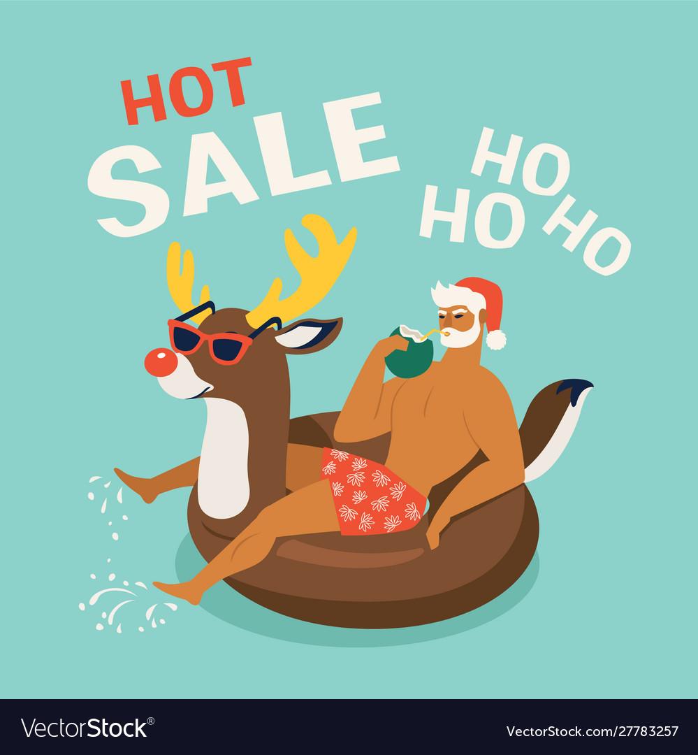 Santa claus wearing a deer swim ring tropical