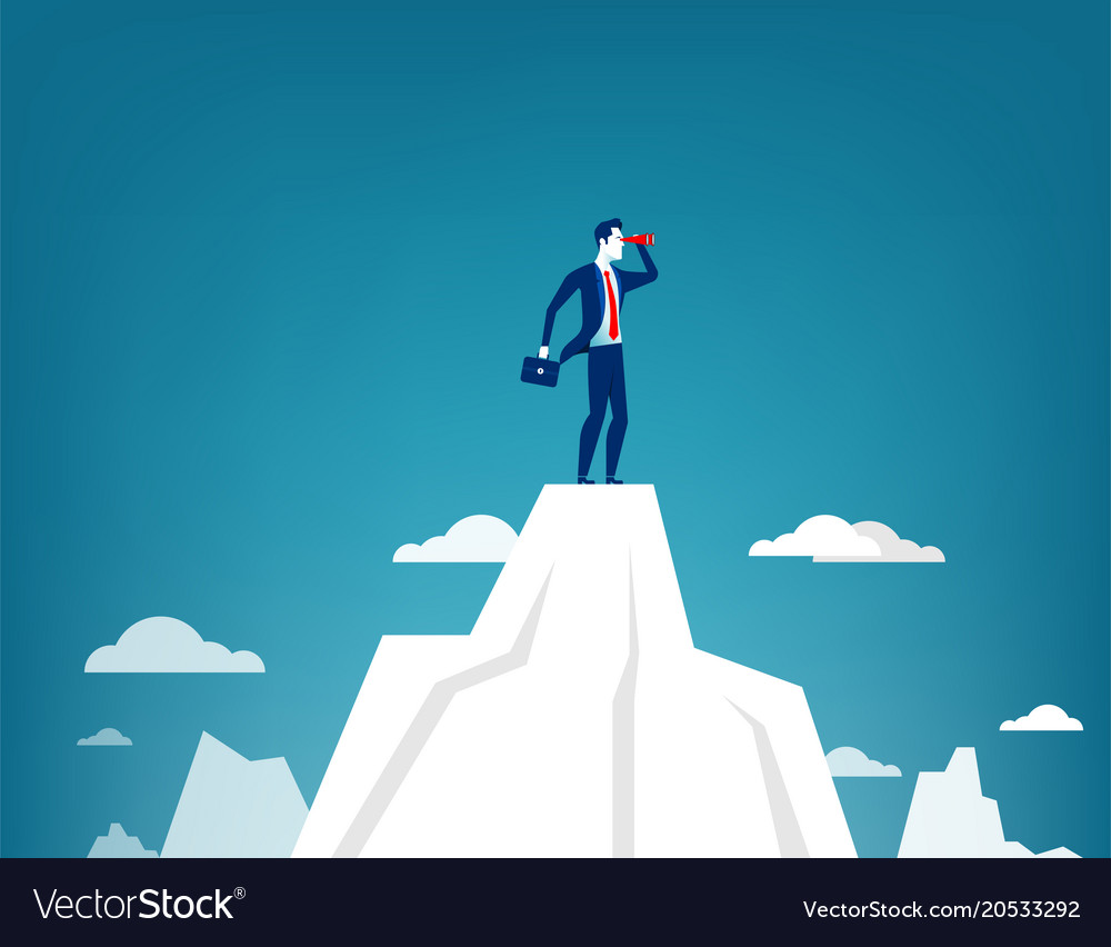 Businessman standing on top of the mountain
