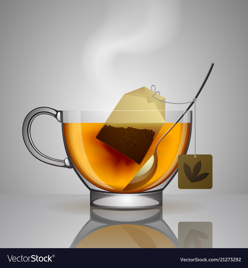 Transparent glass cup with tea bag spoon and hot