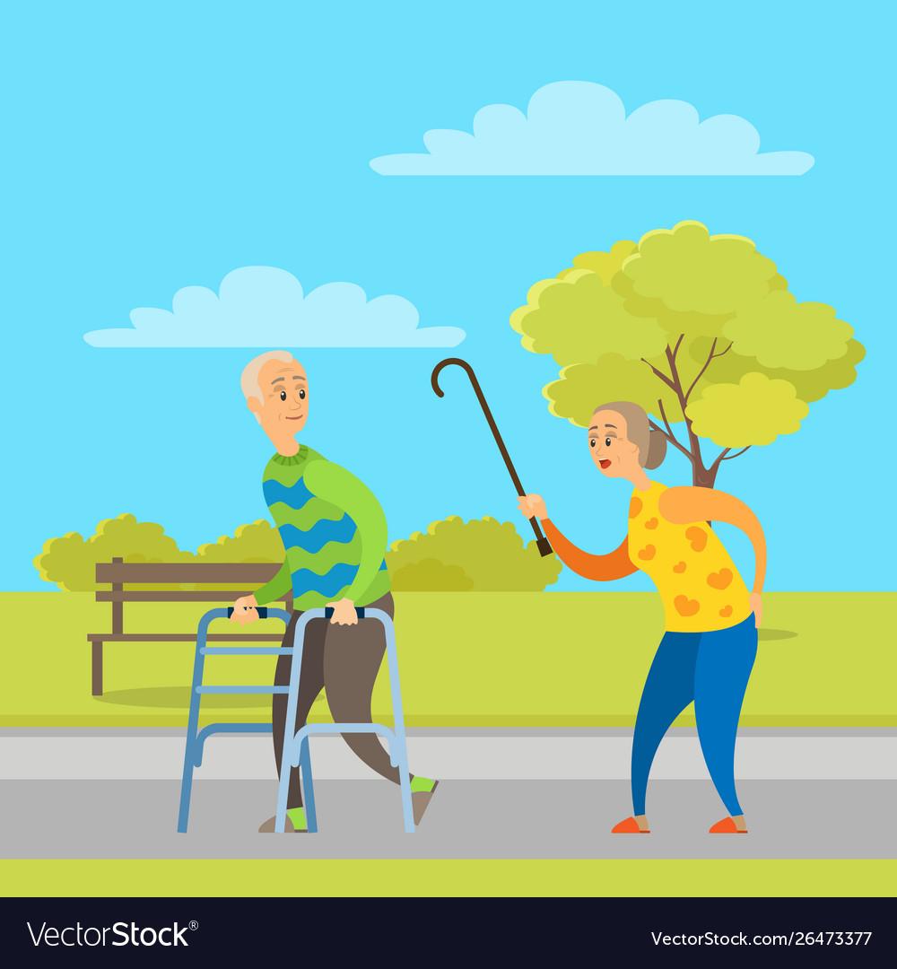 Aged people walking in park pensioner