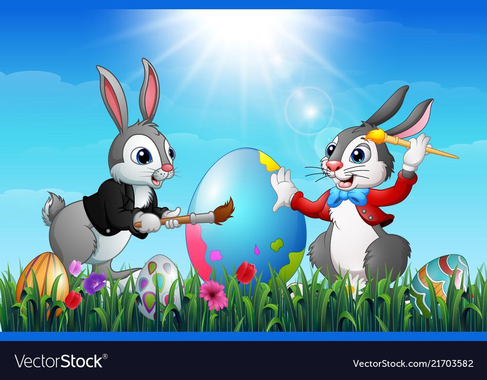 Two easter bunnies painting an eggs in a field