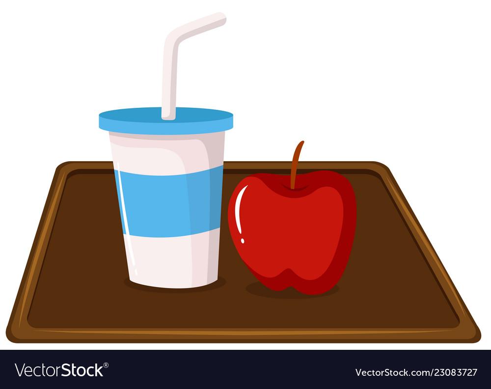 Apple and a milkshake on tray