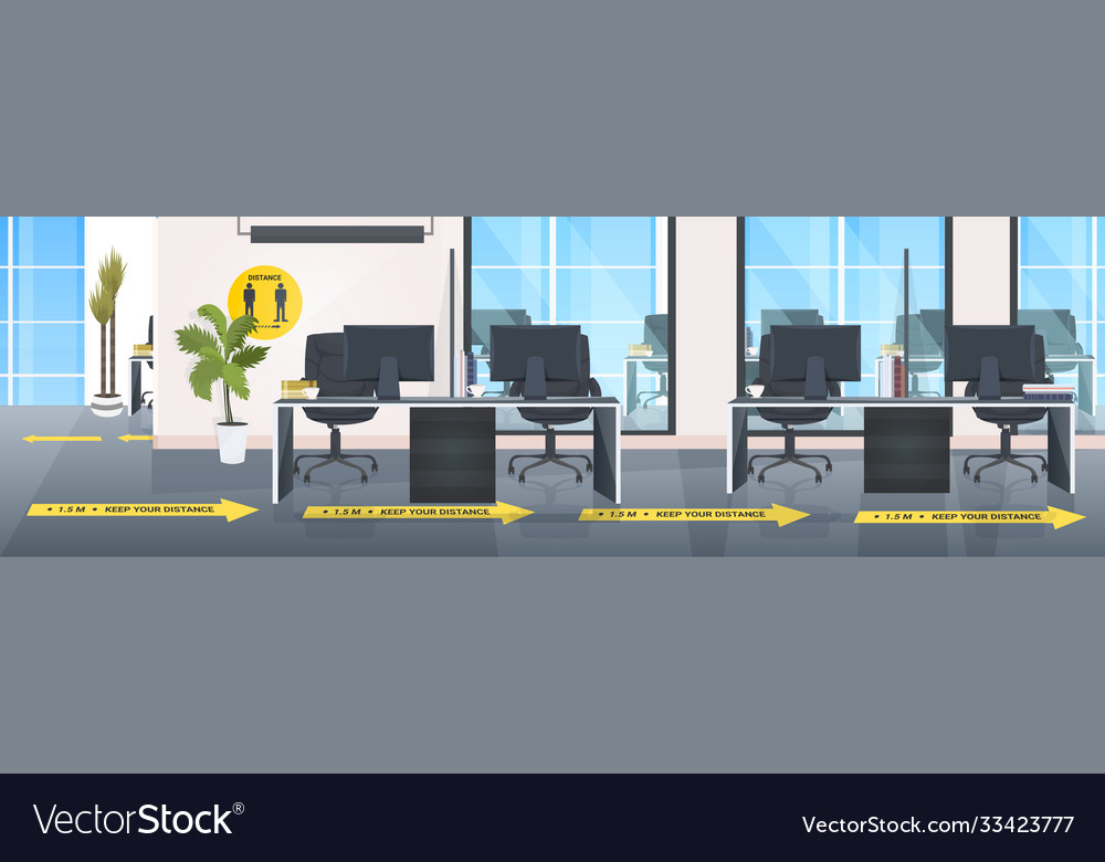 Workplace desks with yellow arrows signs