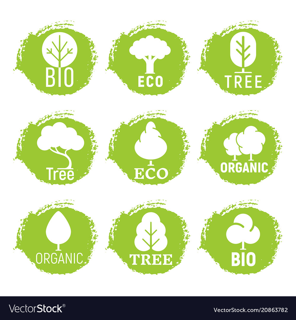 Eco friendly organic tree logos on green grunge