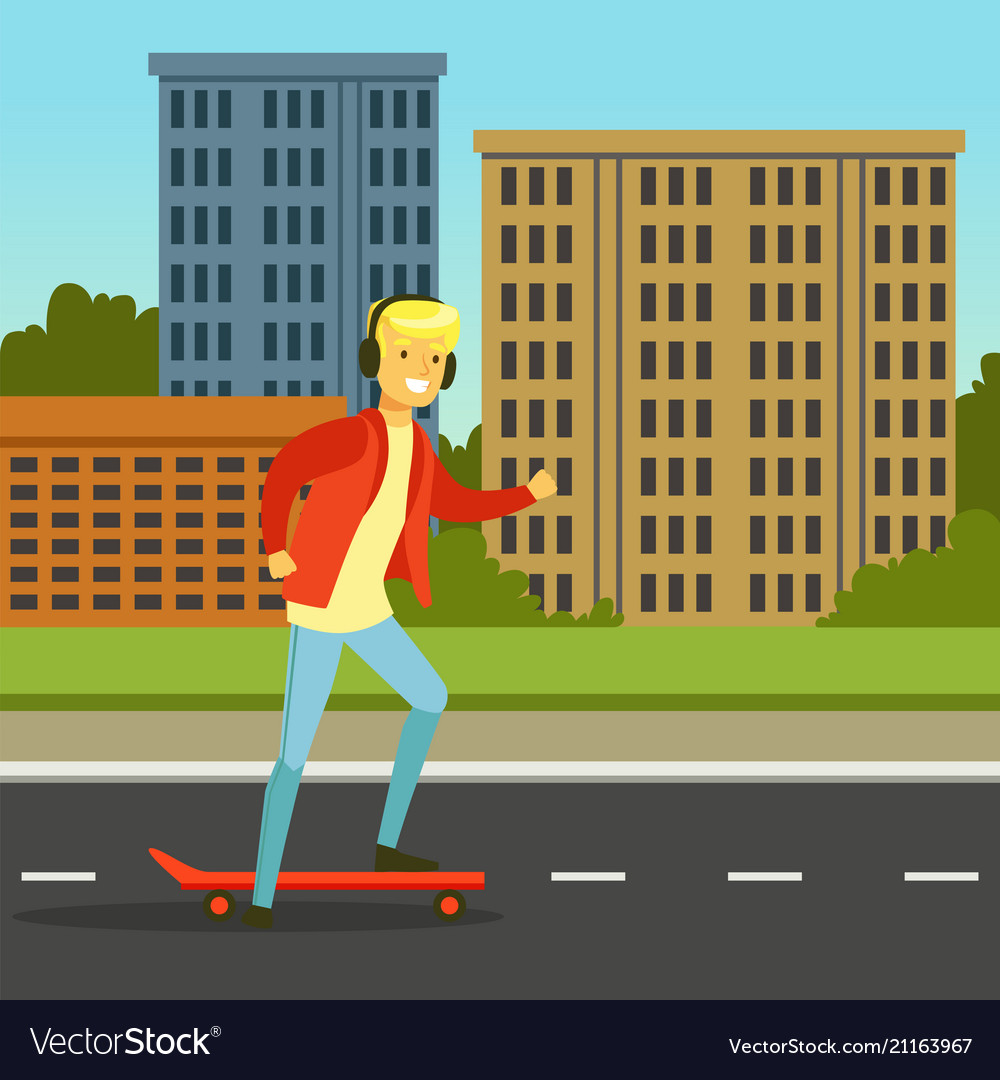 Young man in headphones skateboarding on a city