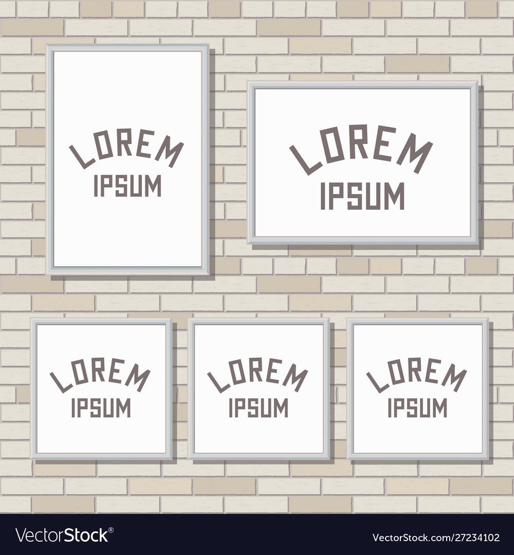 5 mock up frames on light brick wall