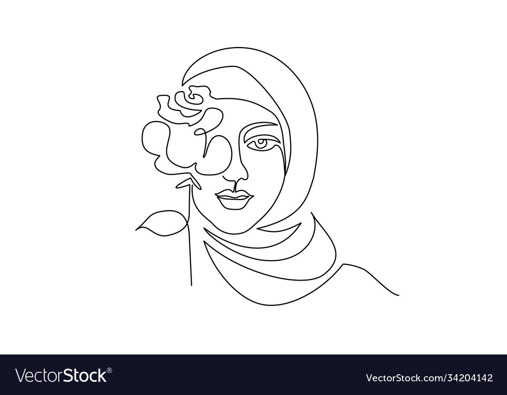Young happy woman in hijab with flowers on her