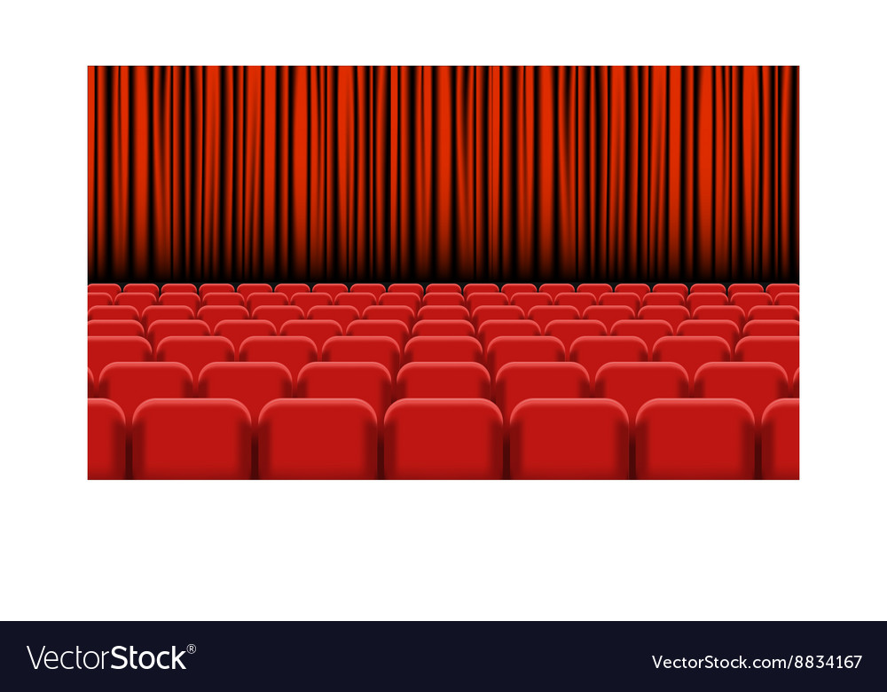 Theater auditorium with rows of red seats and