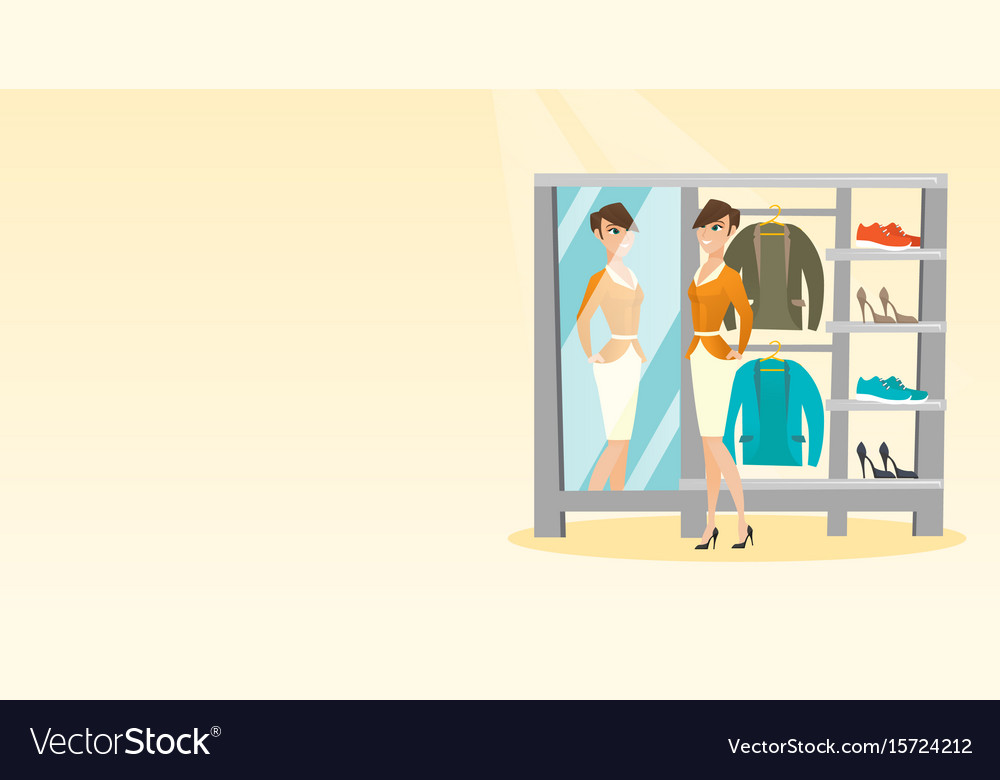 Caucasian woman trying on jacket in dressing room