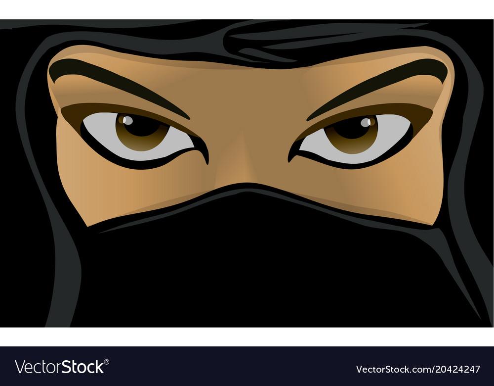 Young woman wearing a black burqa
