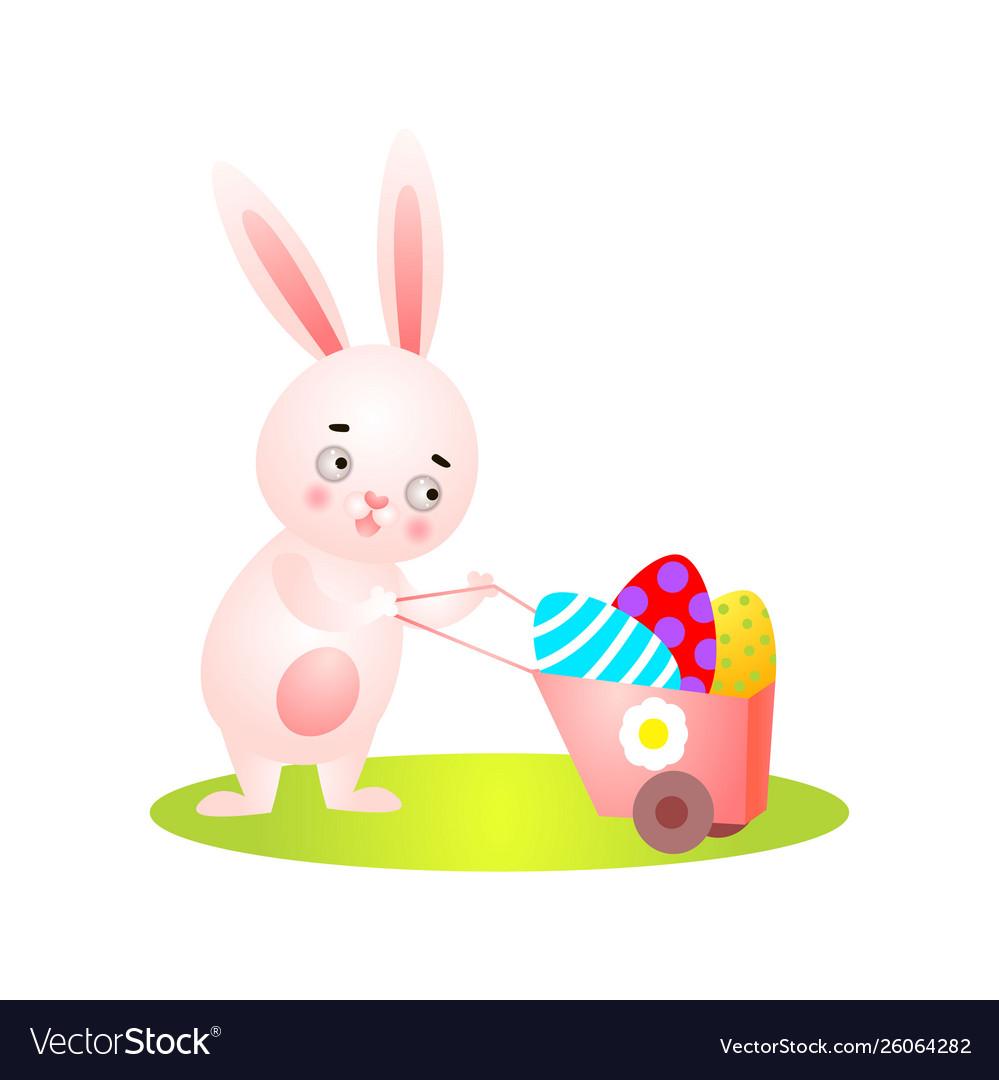 Cute easter rabbit on green grass full wheelbarrow