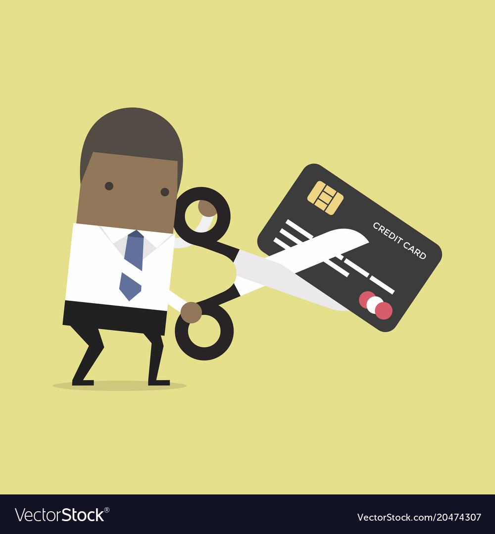 African businessman cutting credit card