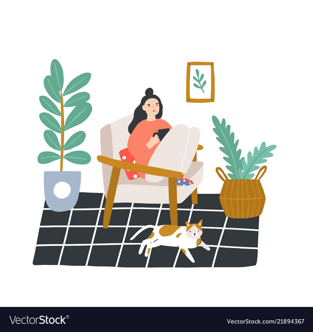 Young girl sitting in comfortable armchair and