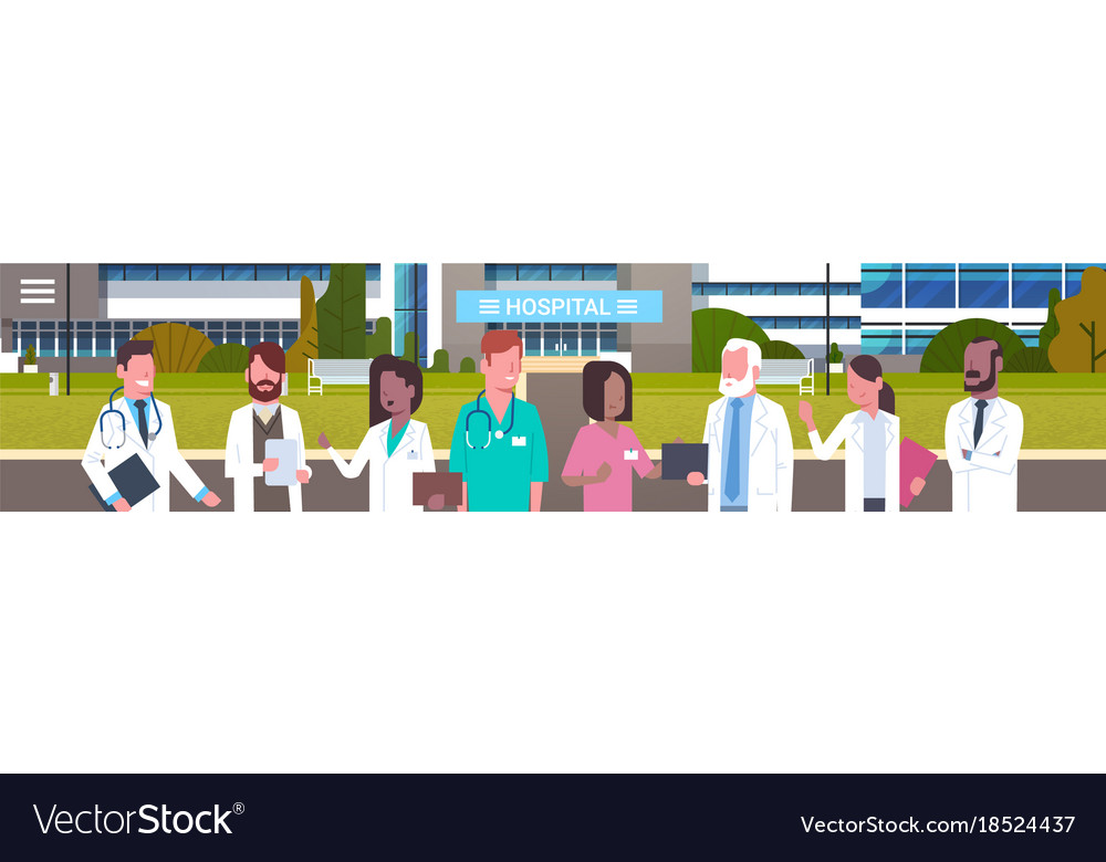 Group of medical doctors standing in front of
