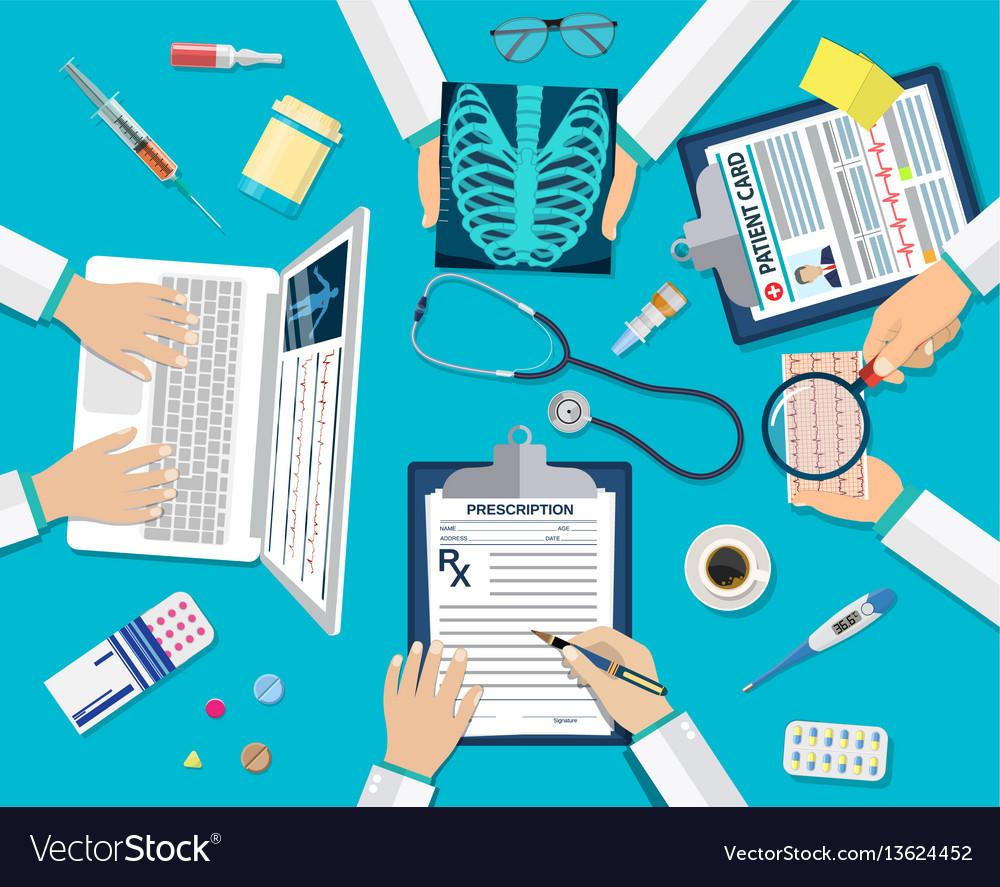 Medical team doctors at desktop
